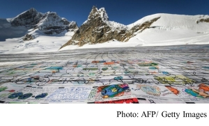 Shrinking Swiss glacier hosts world's largest postcard (BBC - 20181117)
